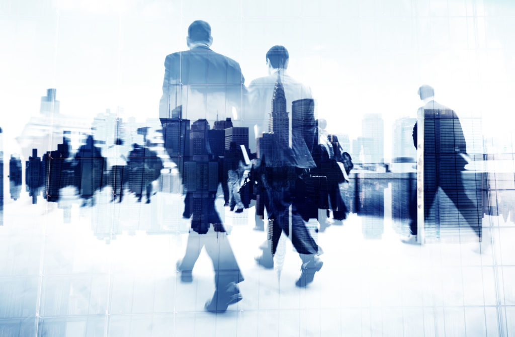 Abstract image of business people walking away against skyscraper sky