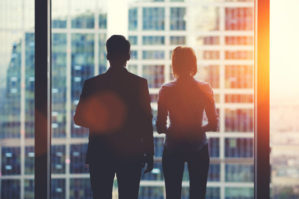 Image of business people silhouetted against a window